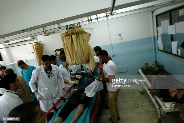Palestinian men carry an injured person at Nasser Hospital in Khan Younis in southern Gaza Strip Israel officially commenced its latest offensive...