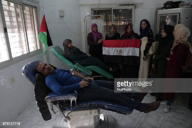 Palestinian men donate blood for the Egyptian victims of the bomb and gun assault on the North Sinai Rawda mosque in Gaza city on November 25 2017...