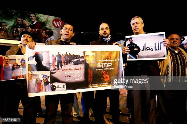Palestinian men holds a posters of all the victims of terrorism including the Palestinian teenager Mohammed Abu Khdeir who was burnt alive by Israeli...