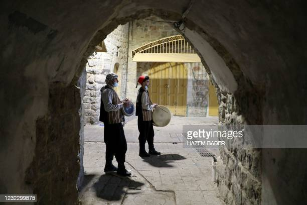 """Palestinian men, known as """"Musaharatis"""" or """"Ramadan drummers"""" who play the traditional role of """"Ramadan drummers"""" awakening Muslims for the pre-dawn..."""