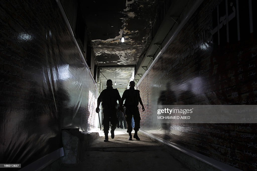 Palestinian men visit a building which used to be an Israeli prison to keep Palestinians during Israel's occupation of Gaza, on April 11, 2013, as part of a tour organized by Hamas to show the facility that has now turned into a memorial center, in Gaza City. Israel has evacuated its settlements and army posts in the Gaza Strip in 2005 .