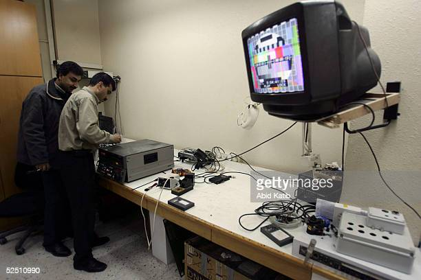 Palestinian men work in the fixing department of the official Palestinian Satellite Channel March 22 in Gaza City Gaza Strip Maher AlRayes chief of...