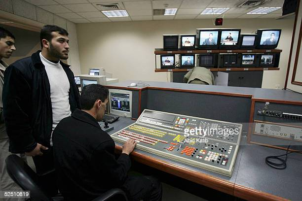 Palestinian men work in the production department of the official Palestinian Satellite Channel March 22 in Gaza City Gaza Strip Maher AlRayes chief...