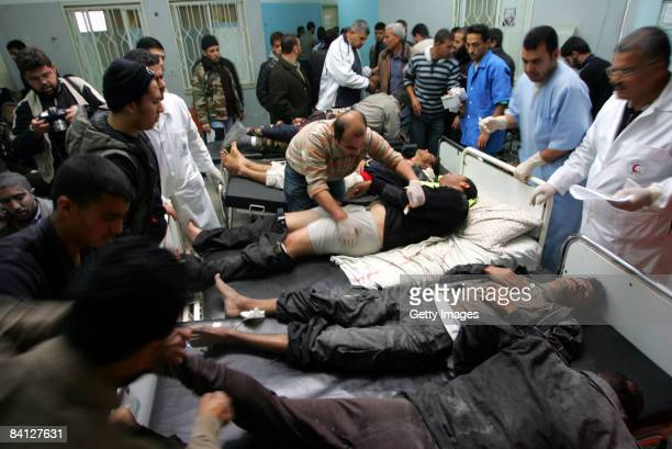 Palestinian men wounded during an Israeli air strike receive medical attention at a hospital in the southern town of Rafah on December 27 2008 in...