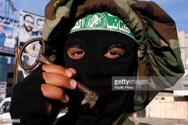 Palestinian militant from Izz al-Din al-Qassam Brigades, of Hamas holds a key during the marking of Nakba or the ''Day of Catastrophe'' in Rafah in...