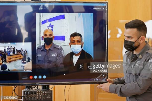 Palestinian militant Mohammad Ardah attends via Zoom a court session in the Israeli city of Nazareth on September 19, 2021. - Ardah, one of the six...