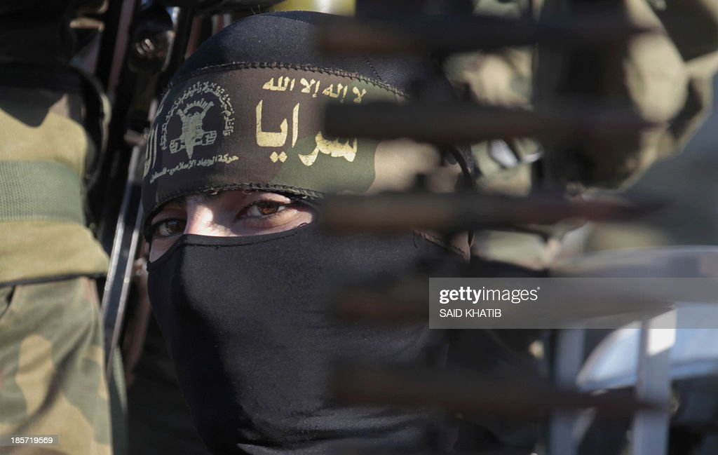 A Palestinian militant of the Islamic Jihad takes part in a rally against Israel in the southern Gaza Strip town of Rafah, on October 24, 2013.