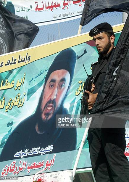 Palestinian militant of the Popular Resistance Committees stands next to a poster picturing recentlykilled AlQaeda leader in Iraq Abu Musab alZarqawi...