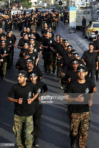 Palestinian militants from AlAqsa Martyr's Brigade an armed off shoot of the former ruling Fatah party shout slogans as they parade in a rally May 21...