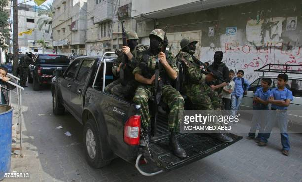 Palestinian militants from the Al-Aqsa Martyrs' Brigades, an armed offshoot of Fatah party, take positions in Gaza City 09 May 2006 during clahses...
