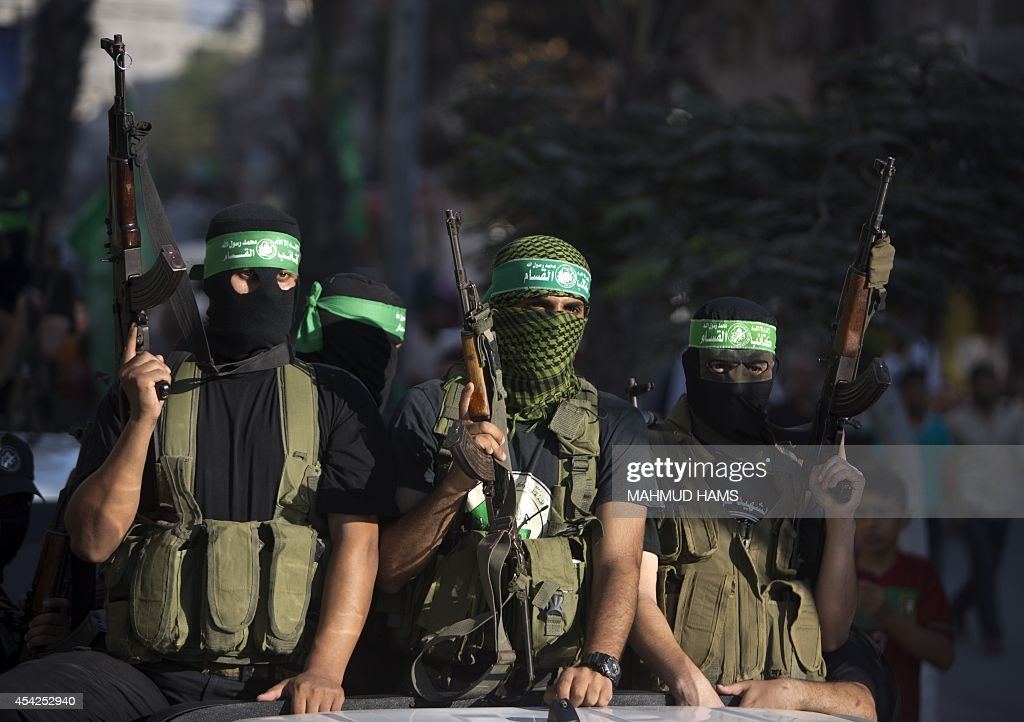 Palestinian militants from the Ezzedine al-Qassam Brigades, Hamas' armed wing, take part in a rally in Gaza City on August 27, 2014, following a deal hailed by Israel and the Islamist movement as 'victory' in the 50-day war. The agreement, effective from 1600 GMT on August 26, saw the warring sides agree to a 'permanent' ceasefire which Israel said would not be limited by time, in a move hailed by Washington, the United Nations and top world diplomats.