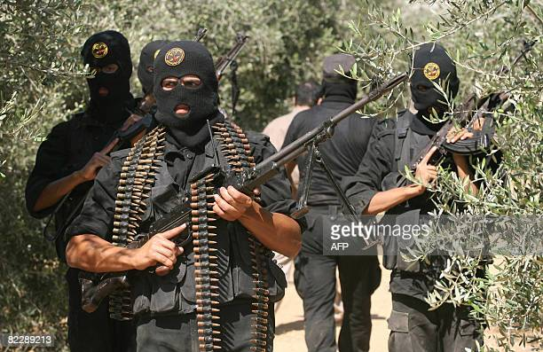 Palestinian militants from the Islamic Jihad's armed wing are seen training with arms at an undisclosed location in the Gaza Strip on August 13 2008...