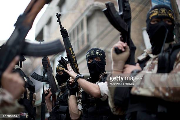 Palestinian militants from the Islamic Jihad's armed wing the AlQuds Brigades attend the funeral of their three comrades in Khan Yunis in the...