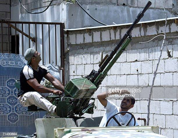Palestinian militants man an antiaircraft machine gun in Ain ElHelweh refugee camp in Saida forty km south of Beirut 13 July 2006 At least forty...