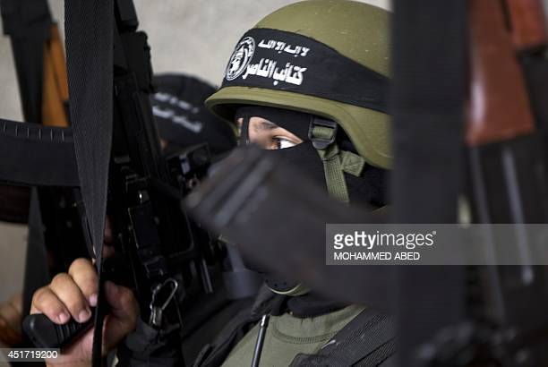 Palestinian militants of alNasser Salah alDeen Brigades the armed wing of the Popular Resistance Committees give a press conference in Gaza City on...