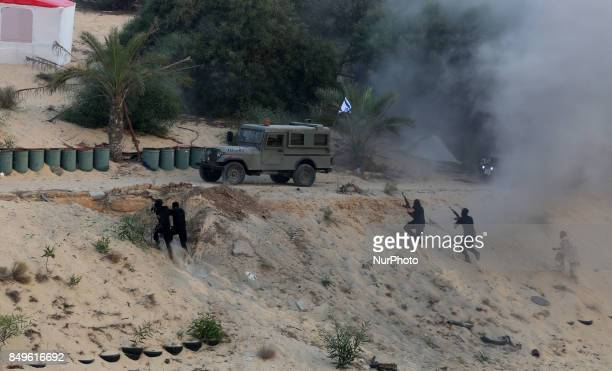 Palestinian militants of the alNasser Saladin Brigades take part in a drill in Khan Younis in the southern Gaza Strip September 19 2017