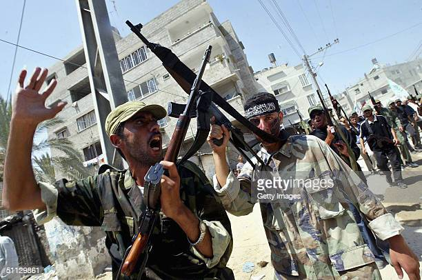 Palestinian militants shout during a march for the funerals of Amr Abu Suta and Zaki Abu Zarqa on July 30 2004 in Khan Yunis refugee camp in southern...