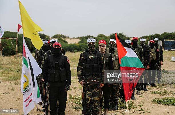 Palestinian militants take part in an antiIsrael joint drill by National Resistance Brigades and Abdel Qader al Husseini Brigades of the armed wing...