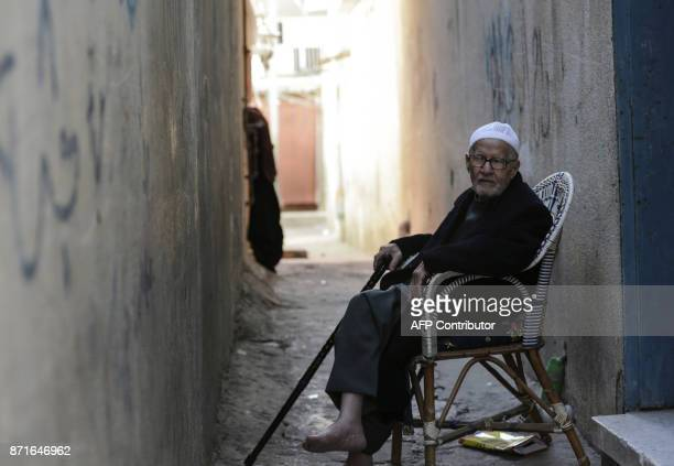 Palestinian Mohammed Hilleyel sits outside his home in the Gaza Strip's Nuseirat refugee camp on October 29 2017 It was just 67 words written in a...