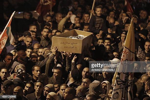 Palestinian mourners attend the funeral of bus driver Yusuf Hasan alRamuni in the West Bank town of Abu Dis from Jerusalem on November 17 2014 A...