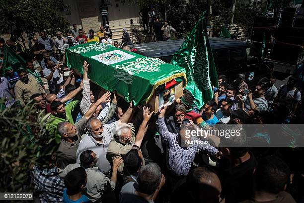 Palestinian mourners attend the funeral of the two Hamas members Adel and Imad Awadallah killed in 1998 after Israel returned the remains of four...