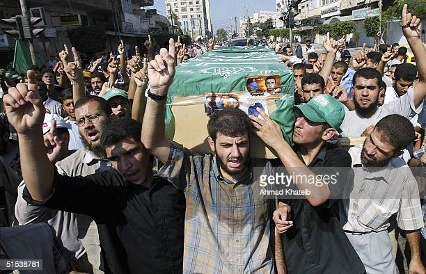 Palestinian mourners carry the body of Adnan alGhoul a senior member of the Hamas militant group and a master bombmaker who has been on Israel's...