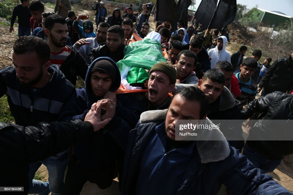 Palestinian mourners carry the body of Amir Abu Musaid, 16, during his funeral in the al-Maghazi refugee camp, located in in the centre of the Gaza Strip, after he was shot dead in clashes with the Israeli military along the Gaza border the previous day, on January 12, 2018.