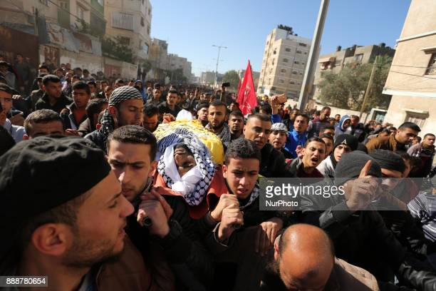 Palestinian mourners carry the body of Mahmoud alMasri a 30yearold Palestinian man who was killed the previous day in clashes with Israeli troops...