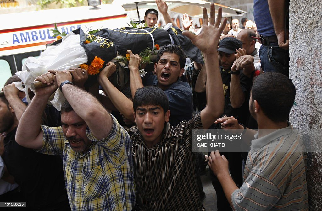 Palestinian mourners carry the body of Mohamed Shahoan during his funeral in the southern Gaza Strip town of Khan Yunis on June 2, 2010, one day after he was shot dead by Israeli troops as he inflitrated southern Israel.