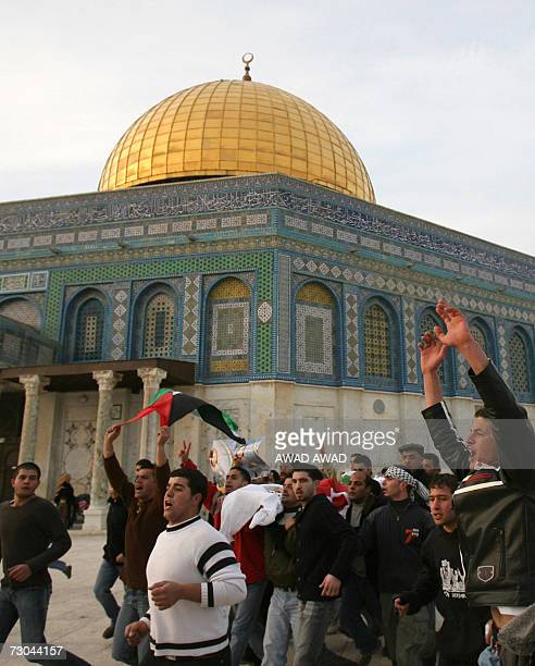 Palestinian mourners carry the body of school girl 10yearold Abir Aramin as her corsage passes in front of the Dome of the Rock in the AlAqsa mosque...