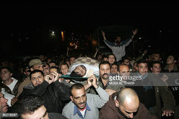 NAME Palestinian mourners carry the body of senior leader of AlAqsa Martyrs Brigades Ahmed Balbul after he was killed by Israeli undercover forces in...