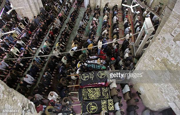 Palestinian mourners pray at the AlOmairi mosque in Gaza City during the funeral service of Palestinians killed yesterday by the Israeli military 07...
