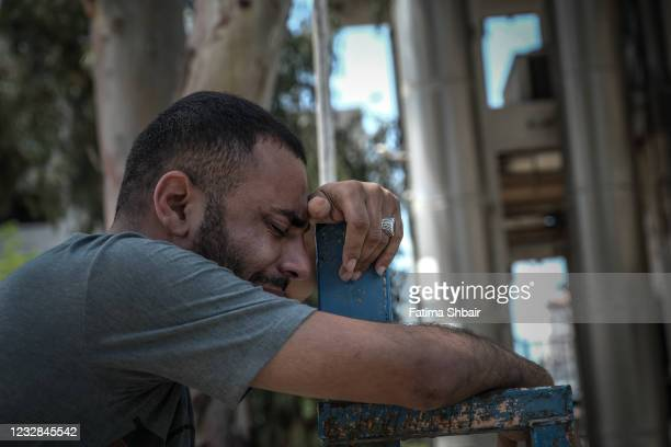 Palestinian mourns for his relative, who was killed during an airstrike on Gaza City on May 12, 2021 in Gaza City, Gaza. At least three dozen...