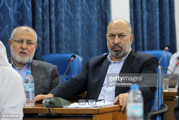 Palestinian MP Ashraf Jomaa attends a Palestinian legislative Council meeting in Gaza City on July 27 2017 following developments at the AlAqsa...