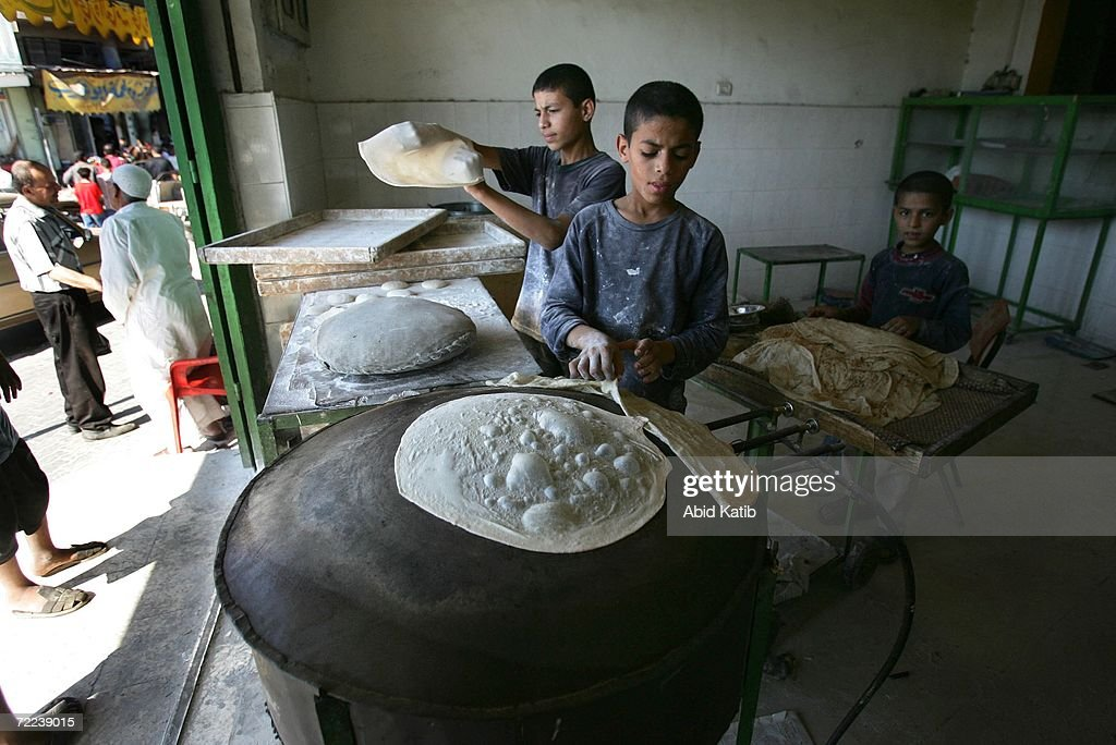Popular Gaza Eid Al-Fitr 2018 - palestinian-muslim-boys-make-a-popular-bread-called-shrak-to-sell-at-picture-id72239015  Photograph_587385 .com/photos/palestinian-muslim-boys-make-a-popular-bread-called-shrak-to-sell-at-picture-id72239015