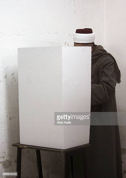 Palestinian muslim Imam votes for the Palestinian legislative candidates in the UN school Alef which is being used as an election station January 25...