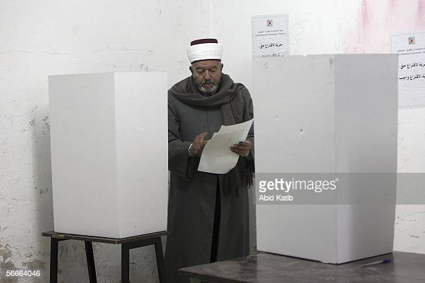 Palestinian muslim Imam votes for the Palestinian legislative candidates in the UN school Alef which is being used as an election stationJanuary 25...