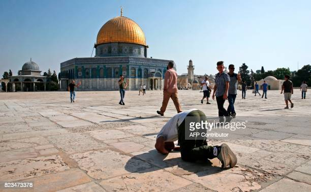 Palestinian Muslim performs sujud a prayer bow in gratitude to God near the Dome of the Rock in the Haram alSharif compound known to Jews as the...