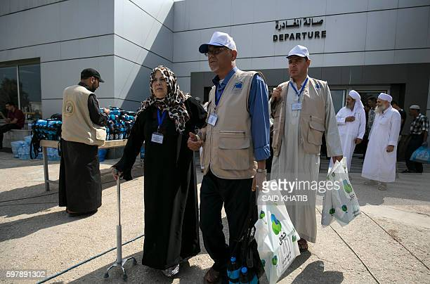 Palestinian Muslim pilgrims arrive at the Rafah border crossing between Egypt and the southern Gaza Strip on August 30 2016 ahead of their departure...