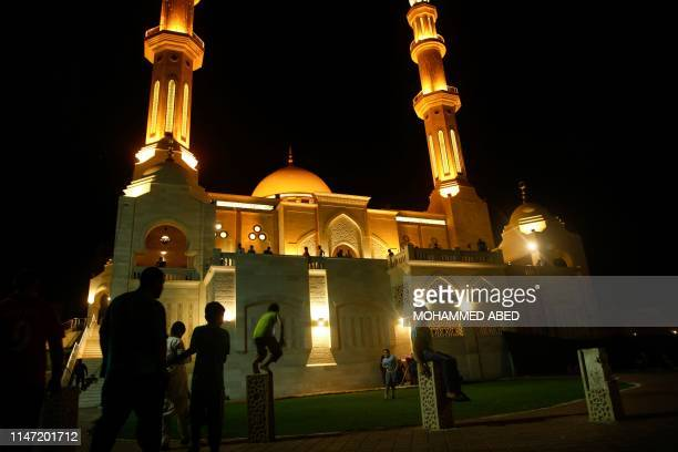 Palestinian Muslim worshippers arrive to pray at a mosque on the occasion of Laylat alQadr also known as the Night of Power in Gaza City on May 31...