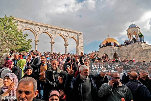 TOPSHOT Palestinian Muslim worshippers chant slogns in front of the Dome of the Rock mosque at the AlAqsa mosque compound in Jerusalem's Old City on...