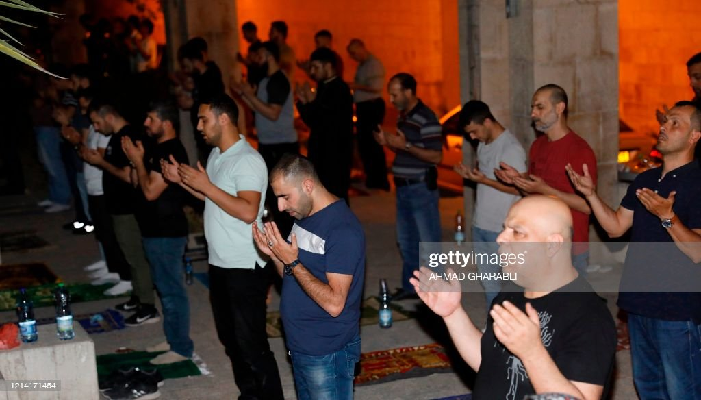 PALESTINIAN-ISRAEL-RELIGION-ISLAM-RAMADAN-HEALTH-VIRUS : News Photo