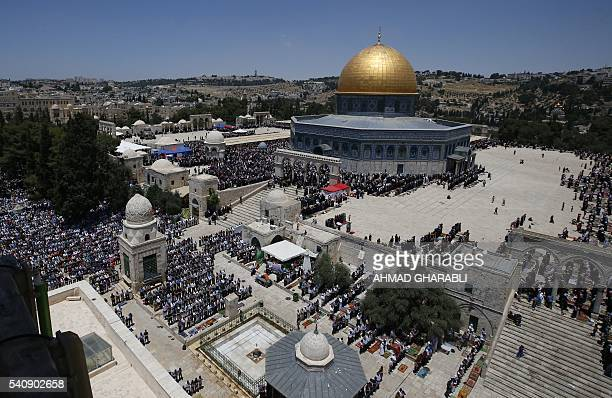 Palestinian Muslim worshippers perform Friday prayer near the Dome of the Rock mosque at the alAqsa mosque compound in Jerusalem's old city on June...