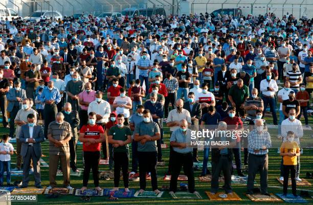 Palestinian Muslim worshippers pray on July 31 2020 at the municipal stadium in the village of Dura on the first day of Eid alAdha Eid alAdha is...