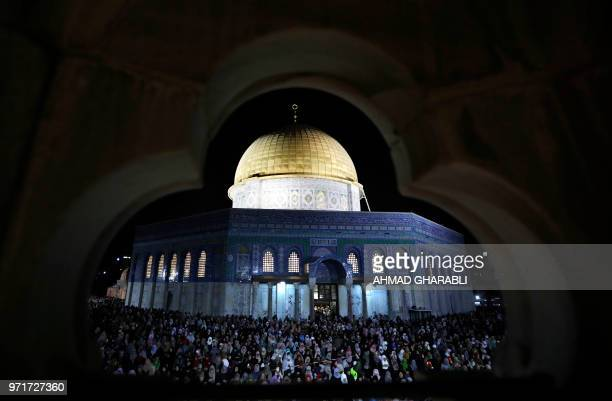 Palestinian Muslim worshippers pray on June 11 2018 outside the Dome of the Rock in the AlAqsa mosques compound in Jerusalem's Old City on the...