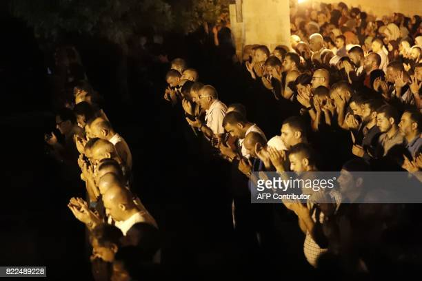 TOPSHOT Palestinian Muslim worshippers pray outside Jerusalem's Old City on July 25 2017 as Muslim officials said worshippers should continue to...
