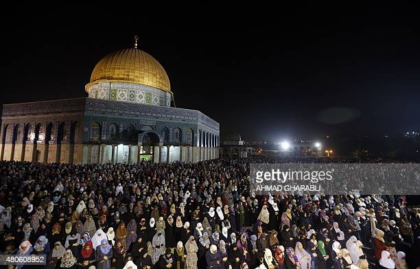 Palestinian Muslim worshippers pray overnight on July 13 2015 outside the Dome of the Rock in the AlAqsa mosques compound in Jerusalem's Old City on...