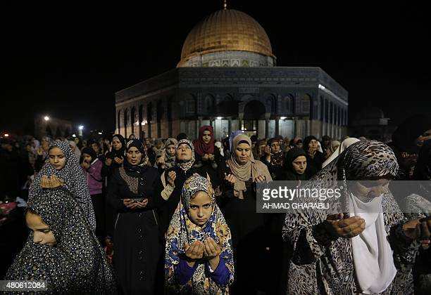 Palestinian Muslim worshippers pray overnight on July 13 2015 outside the Dome of the Rock in the AlAqsa mosque compound in Jerusalem's Old City...
