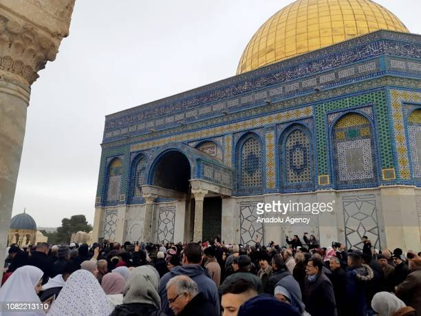 Palestinian Muslims gather in front of the Dome of the Rock after an Israeli policeman attempted to force his way into the place in Jerusalem on...