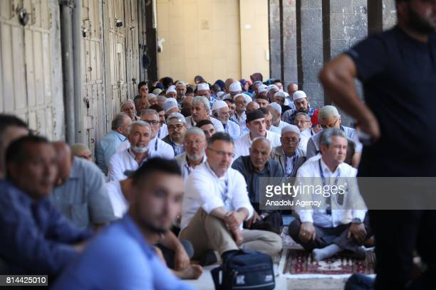 Palestinian Muslims gather to perform Friday prayer outside the Lion's Gate and Damascus Gate after AlAqsa Mosque's doors was closed for Friday...